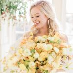 Bridal portrait with yellow roses